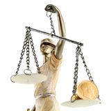 Justice is blind ( ... or maybe not ). Justice (greek:themis,latin:justitia) blindfolded with scales, sword and money (gold coin) on one scale. Corruption and stock photography