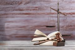 Justice Scales and books and wooden desk royalty free stock image