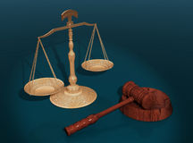 Justice concept. Golden scale and gavel on blue surface Royalty Free Stock Photos