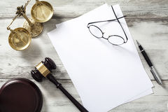 Justice concept with blank paper. On table Stock Photo