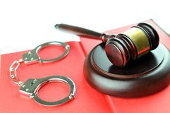 Justice. Concept with gavel and handcuffs on law book Stock Photos