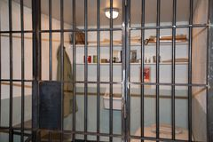 Concept Prison cell with jail iron bars for criminals. Justice Concept Prison cell with jail iron bars for criminals Stock Images