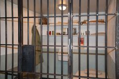 Prison cell with jail iron bars for criminals. Justice Concept Prison cell with jail iron bars for criminals stock image