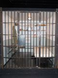 Prison cell with jail iron bars for criminals. Justice Concept Prison cell with jail iron bars for criminals stock photos