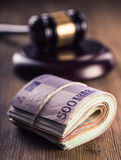 Justice and euro money. Euro currency. Court gavel and rolled Euro banknotes. Representation of corruption and bribery in the judi Stock Image