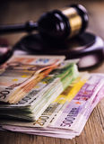 Justice and euro money. Euro currency. Court gavel and rolled Euro banknotes. Representation of corruption and bribery in the judi Royalty Free Stock Image