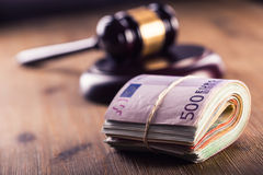 Justice and euro money. Euro currency. Court gavel and rolled Euro banknotes. Representation of corruption and bribery in the judi Stock Photography