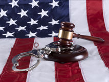 Justice. Gavel, handcuff and American flag Stock Photography