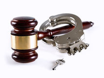 Justice. Gavel and handcuff on white background Stock Images