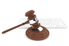 Justice Gavel and keyboard. On a white background Royalty Free Stock Photo