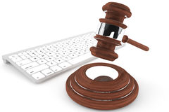 Justice Gavel and keyboard. On a white background Royalty Free Stock Image