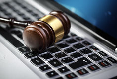 Justice gavel and laptop computer keyboard. Gavel on laptop computer keyboard concept for online internet auction or legal assistance Royalty Free Stock Photo