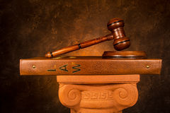 Justice Gavel on a law book. Placed on a Greek column Stock Photo