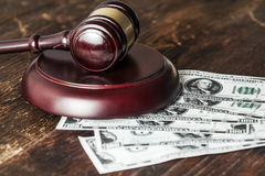Justice gavel and money on the desk Stock Photos