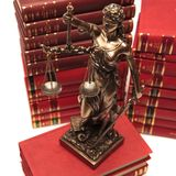 Justice goddess on a book Royalty Free Stock Photography