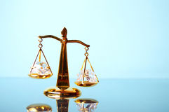 Justice. Gold scales on the mirror Royalty Free Stock Image