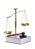 Justice. Golden scales of justice, gavel and law book on a white background Stock Image