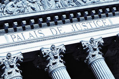 Justice hall. Decorative columns at the facade of an old justice hall building Stock Photos
