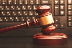 Justice hammer and keyboard. Symbol justice scales of justice criminal law white background isolated Stock Photography