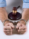 Justice. Hands handcuffed next to a gavel Stock Images