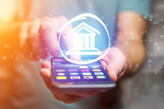 Justice icon going out a smartphone interface - technology conce Stock Image
