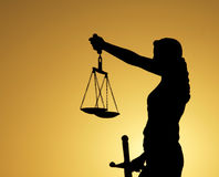 Justice Lady Silhouettes. Justice lady statue with cloudy sky Stock Photo