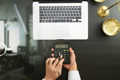 Justice and law concept.businessman or lawyer or accountant work. Ing on accounts using a calculator and laptop computer and documents in modern office Stock Photography
