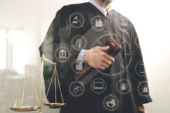 Justice and law concept.Male judge in a courtroom with the gavel Stock Photo