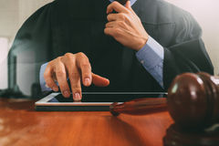 justice and law concept.Male judge in a courtroom with the gavel Stock Photography