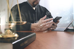 Justice and law concept.Male judge in a courtroom with the gavel Royalty Free Stock Image