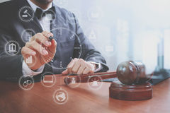 Justice and law concept.Male judge in a courtroom with the gavel Stock Images