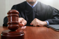 justice and law concept.Male judge in a courtroom striking the g Stock Photo