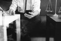 Justice and Law context.Male lawyer hand sitting on sofa and wor Royalty Free Stock Photo