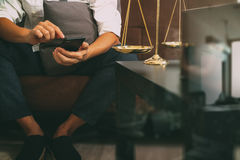 Justice and Law context.Male lawyer hand sitting on sofa and wor Royalty Free Stock Photography