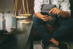Justice and Law context.Male lawyer hand sitting on sofa and wor Stock Photos