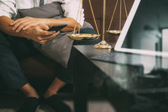 Justice and Law context.Male lawyer hand sitting on sofa and wor Stock Images