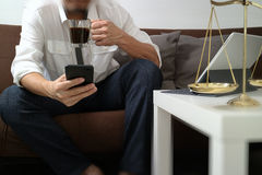 Justice and Law context.Male lawyer hand sitting on sofa and wor Stock Photography