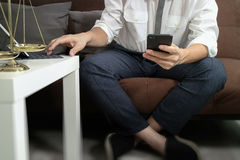 Justice and Law context.Male lawyer hand sitting on sofa and wor Stock Image