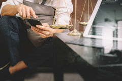 Justice and Law context.Male lawyer hand sitting on sofa and wor Royalty Free Stock Images