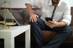 Justice and Law context.Male lawyer hand sitting on sofa and wor Royalty Free Stock Image