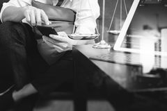 Justice and Law context.Male lawyer hand sitting on sofa and wor Royalty Free Stock Photos