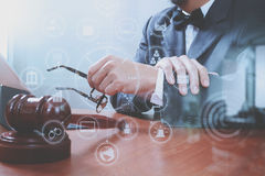 Justice and Law context.Male lawyer hand working with smart phon Royalty Free Stock Photos