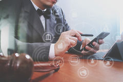Justice and Law context.Male lawyer hand working with smart phon Royalty Free Stock Photo