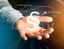 Justice and law symbol displayed on a futuristic interface with. View of a Justice and law symbol displayed on a futuristic interface with business terms Stock Photos