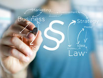 Justice and law symbol displayed on a futuristic interface with. View of a Justice and law symbol displayed on a futuristic interface with business terms Stock Images