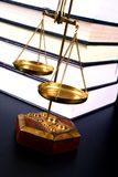 Justice scale. Scale in front of books Stock Photos