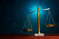 Justice scale on blue background Stock Photography