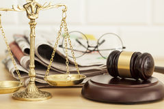 Justice scale with gavel, newspaper and eyeglasses Stock Image