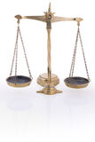 Justice scales. Balance scales symbol of justice on white backround with reflection Stock Photos