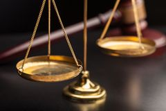 Justice Scales and wooden gavel on wooden table. Justice scales gavel background paper closeup stock image
